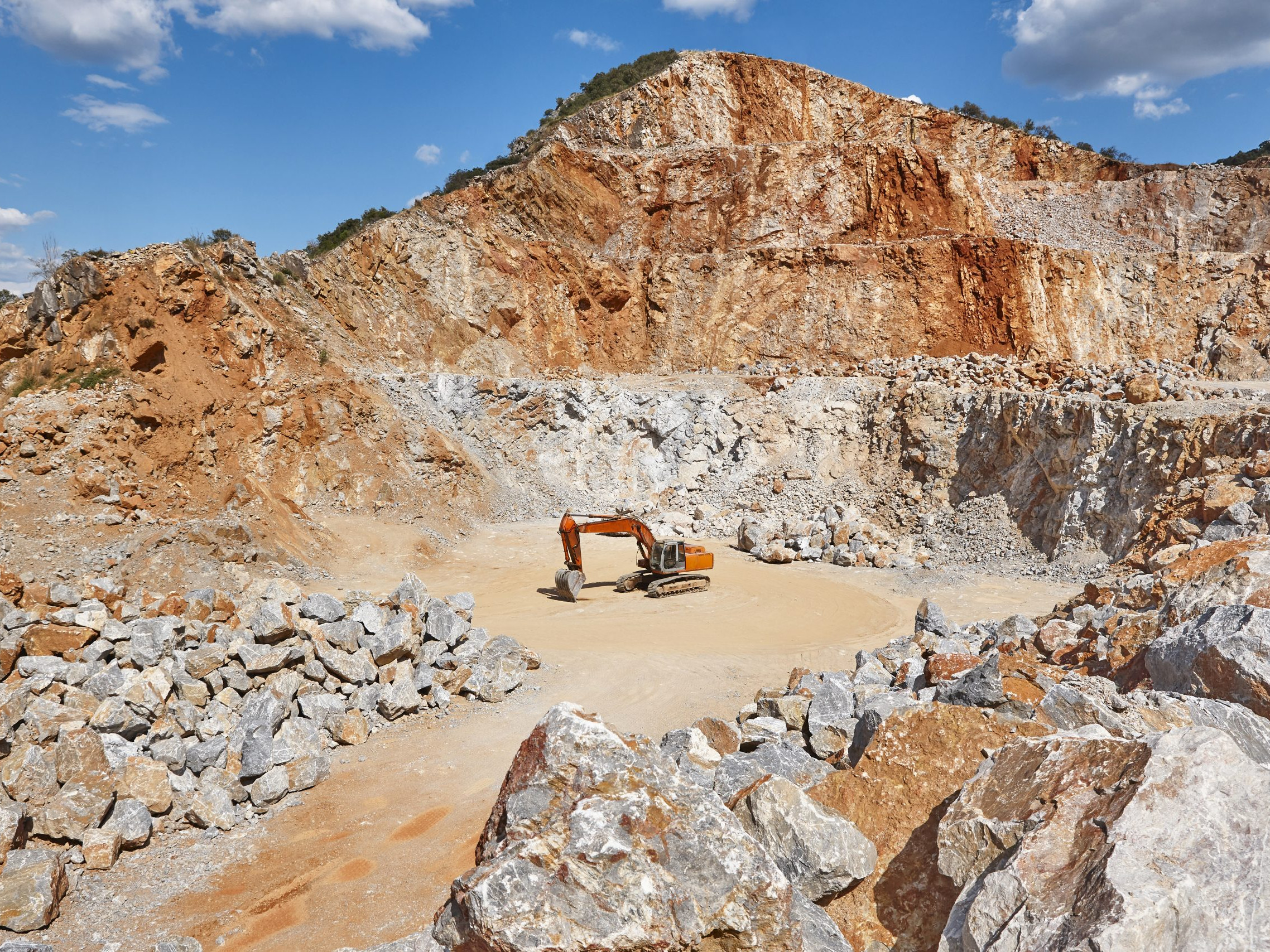 Heavy excavator on a quarry. Excavation machinery.